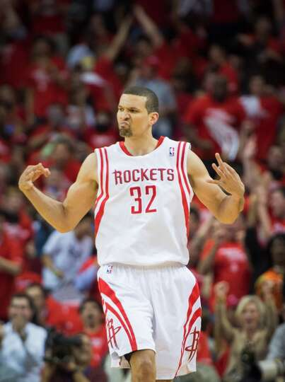 Rockets guard Francisco Garcia celebrates after making a 3-pointer during the first half.