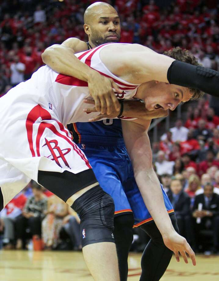 Thunder point guard Derek Fisher fouls Houston center Omer Asik. Photo: James Nielsen, Houston Chronicle