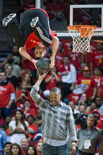 Former Rockets player Steve Francis participates in a slam dunk demonstration during a time out in t
