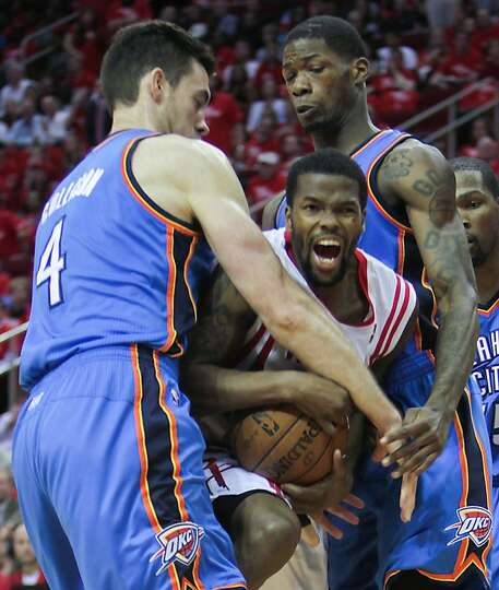 Rockets point guard Aaron Brooks is double-teamed by Thunder forward Nick Collison and the guard DeA