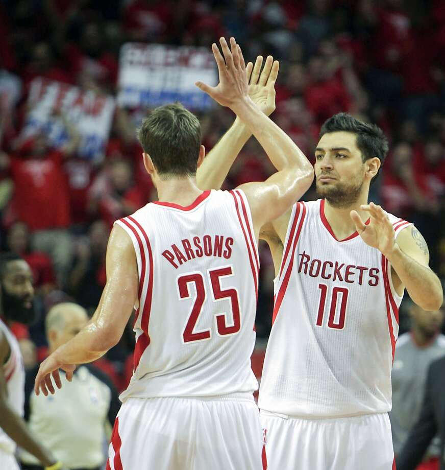 Rockets forward Chandler Parsons and shooting guard Carlos Delfino celebrate during the second half. Photo: James Nielsen, Houston Chronicle