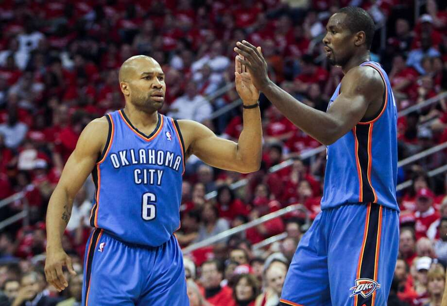 Thunder point guard Derek Fisher celebrates with teammate Serge Ibaka. Photo: James Nielsen, Houston Chronicle