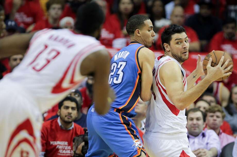 Rockets forward Carlos Delfino tries to back down Thunder guard Kevin Martin. Photo: James Nielsen, Houston Chronicle