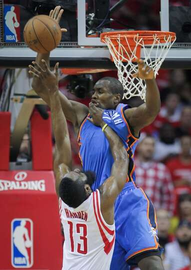 Serge Ibaka of the Thunder blocks a shot from Rockets shooting guard James Harden.