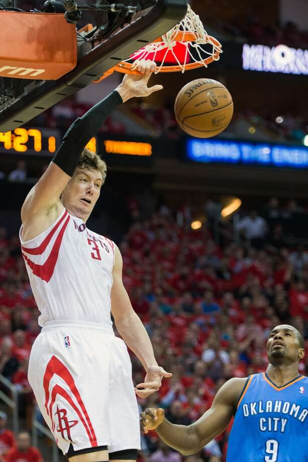 Rockets center Omer Asik dunks past Thunder forward Serge Ibaka. Photo: Smiley N. Pool, Houston Chronicle
