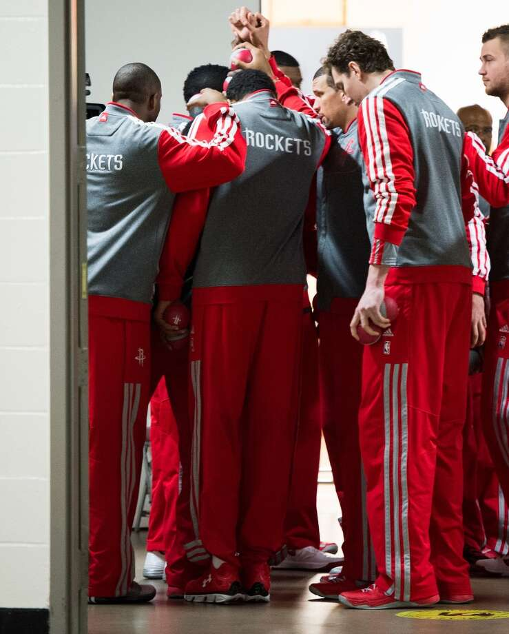 Rockets players huddle in the hallway outside the locker room before facing the Thunder. Photo: Smiley N. Pool, Houston Chronicle