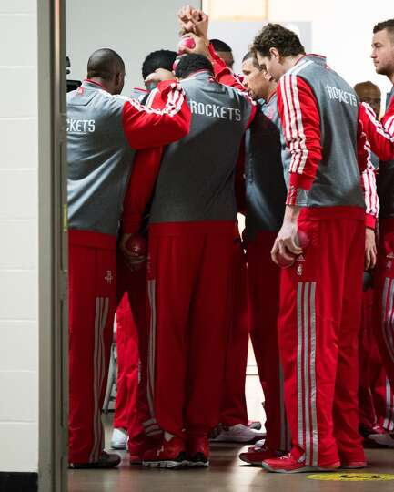 Rockets players huddle in the hallway outside the locker room before facing the Thunder.