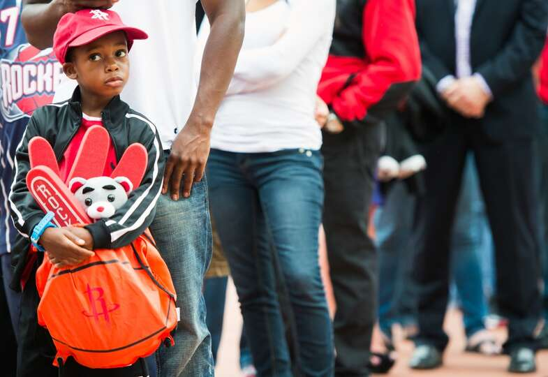 Christopher Turner, 6, waits in line for the gates to open.