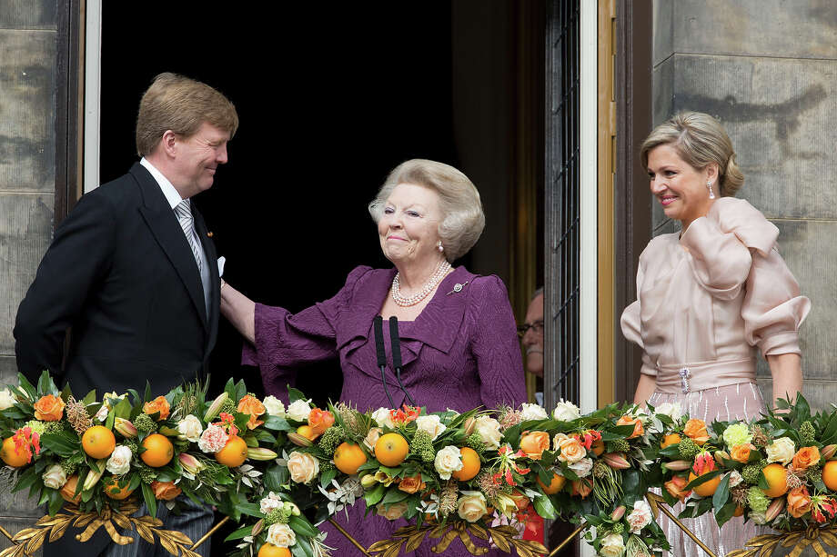 HM King Willem Alexander of the Netherlands, HRH Princess Beatrix of the Netherlands and and HM Queen Maxima of Holland of the Netherlands appear on the Balcony of the Royal Palace in Amsterdam to greet the public after her abdication and ahead of the inauguration of HM King Willem Alexander of the Netherlands on April 30, 2013 in Amsterdam, Netherlands. Photo: Julian Parker, UK Press Via Getty Images / 2013 Julian Parker