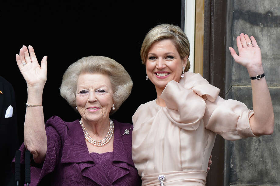 Princess Beatrix of the Netherlands (L) and Queen Maxima (R) appear on the balcony of the Royal Palace to greet the public after her abdication and ahead of the Inauguration of King Willem Alexander of The Netherlands on April 30, 2013  in Amsterdam, Netherlands. Photo: Pascal Le Segretain, Getty Images / 2013 Getty Images