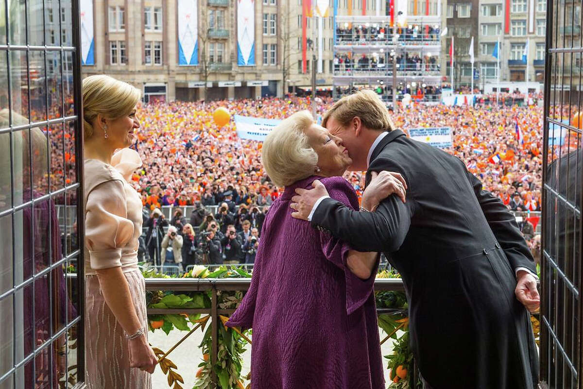 In this handout image provided by RVD, HRH Princess Beatrix of the Netherlands kisses her son HM King Willem-Alexander of the Netherlands as Queen Maxima of the Netherlands looks on during a short address on the balcony of the Royal Palace to greet the public after the abdication of Queen Beatrix of The Netherlands and ahead of the Inauguration of King Willem Alexander of The Netherlands on April 30, 2013 in Amsterdam, Netherlands.