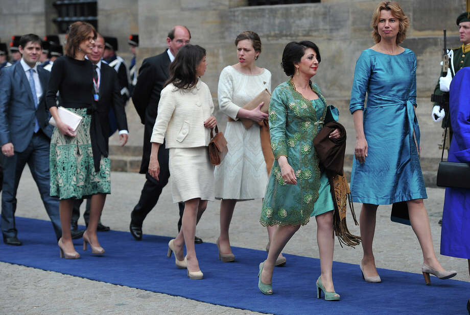 Members of Parliament arrive to attend the inauguration of HM King Willem Alexander of the Netherlands and HRH Princess Beatrix of the Netherlands at New Church on April 30, 2013 in Amsterdam, Netherlands. Photo: Pool, Getty Images / 2013 Getty Images
