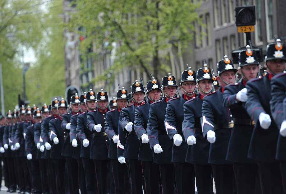 Ceremonial militaries march for the inauguration of HM King Willem Alexander of the Netherlands and HRH Princess Beatrix of the Netherlands at New Church on April 30, 2013 in Amsterdam, Netherlands. Photo: Pool, Getty Images / 2013 Getty Images