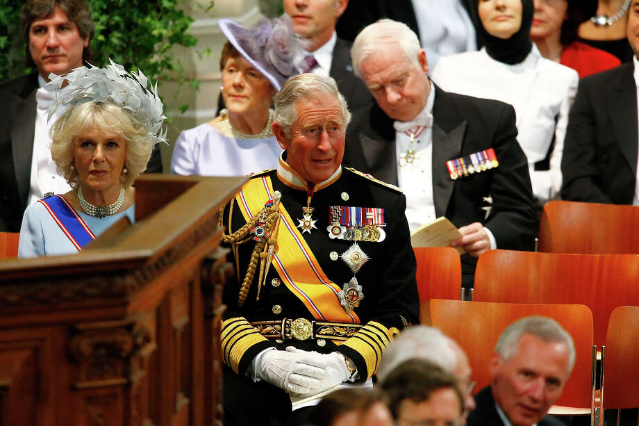 Britain's Prince Charles, Prince of Wales and Camilla, Duchess of Cornwall attend the inauguration of HM King Willem Alexander of the Netherlands and HRH Princess Beatrix of the Netherlands at New Church on April 30, 2013 in Amsterdam, Netherlands. Photo: Pool, Getty Images / 2013 Getty Images