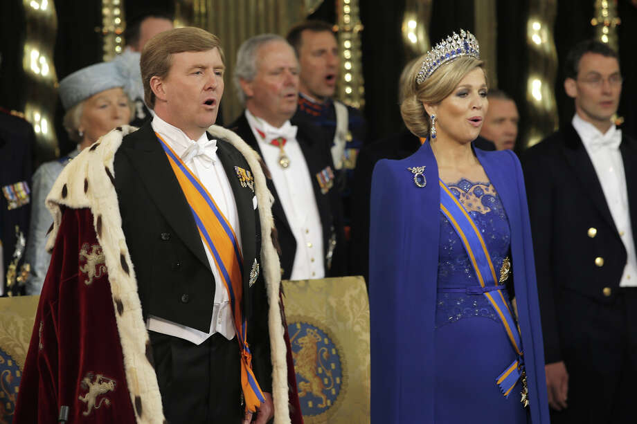 HM King Willem Alexander of the Netherlands and his wife HRH Princess Beatrix of the Netherlands stand with members of the royal household on during their inauguration ceremony at New Church on April 30, 2013 in Amsterdam, Netherlands. Photo: Pool, Getty Images / 2013 Getty Images