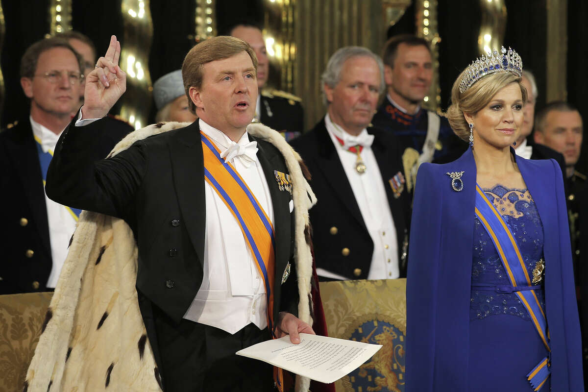 HM King Willem Alexander of the Netherlands takes the oath as his wife HRH Princess Beatrix of the Netherlands looks on during their inauguration ceremony at New Church on April 30, 2013 in Amsterdam, Netherlands.
