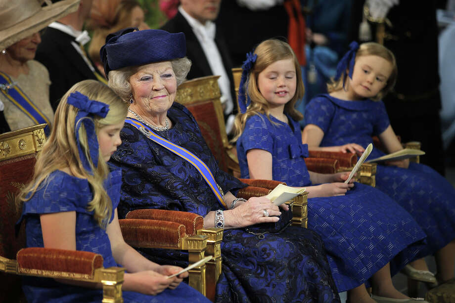 Queen Beatrix of The Netherlands (2nd-L), sits with her granddaughters Princess Catharina Amalia, Princess Alexia and Princess Ariane during the inauguration ceremony of HM King Willem Alexander of the Netherlands and HM Queen Maxima of the Netherlands at New Church on April 30, 2013 in Amsterdam, Netherlands. Photo: Pool, Getty Images / 2013 Getty Images