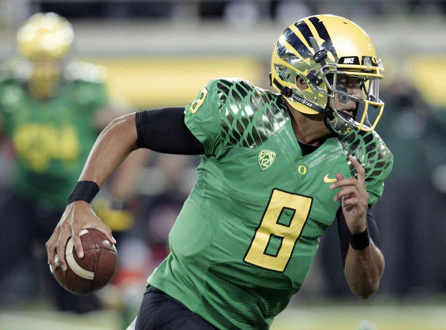 Marcus Mariota Oregon quarterback 18/1 odds Photo: Don Ryan, Associated Press / AP