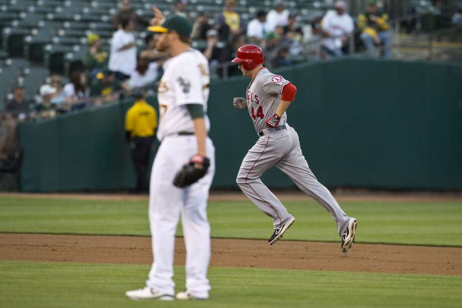 Mark Trumbo (44) of the Los Angeles Angels of Anaheim rounds the bases after hitting a home run off of Dan Straily (67) of the Oakland Athletics during the second inning at O.co Coliseum on April 29, 2013 in Oakland, California.
