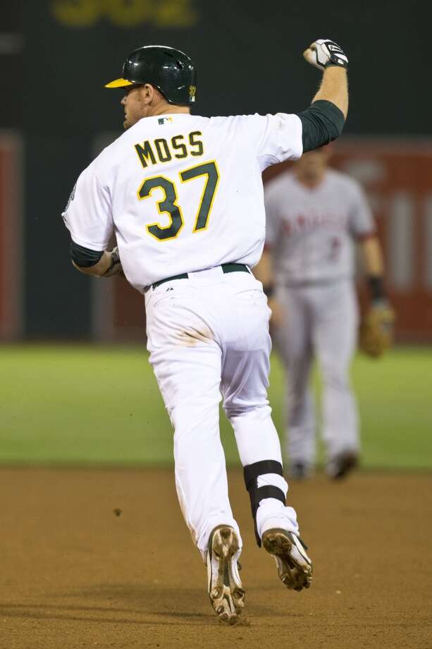 Brandon Moss (37) of the Oakland Athletics celebrates after hitting a walk off two run home run against the Los Angeles Angels of Anaheim during the nineteenth inning at O.co Coliseum on April 30, 2013 in Oakland, California. The Oakland Athletics defeated the Los Angeles Angels of Anaheim 10-8 in 19 innings.