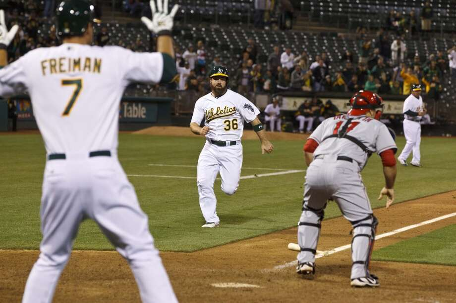 Derek Norris (36) of the Oakland Athletics scores a game tying run during the nineteenth inning against the Los Angeles Angels of Anaheim at O.co Coliseum on April 30, 2013 in Oakland, California. The Oakland Athletics defeated the Los Angeles Angels of Anaheim 10-8 in 19 innings.