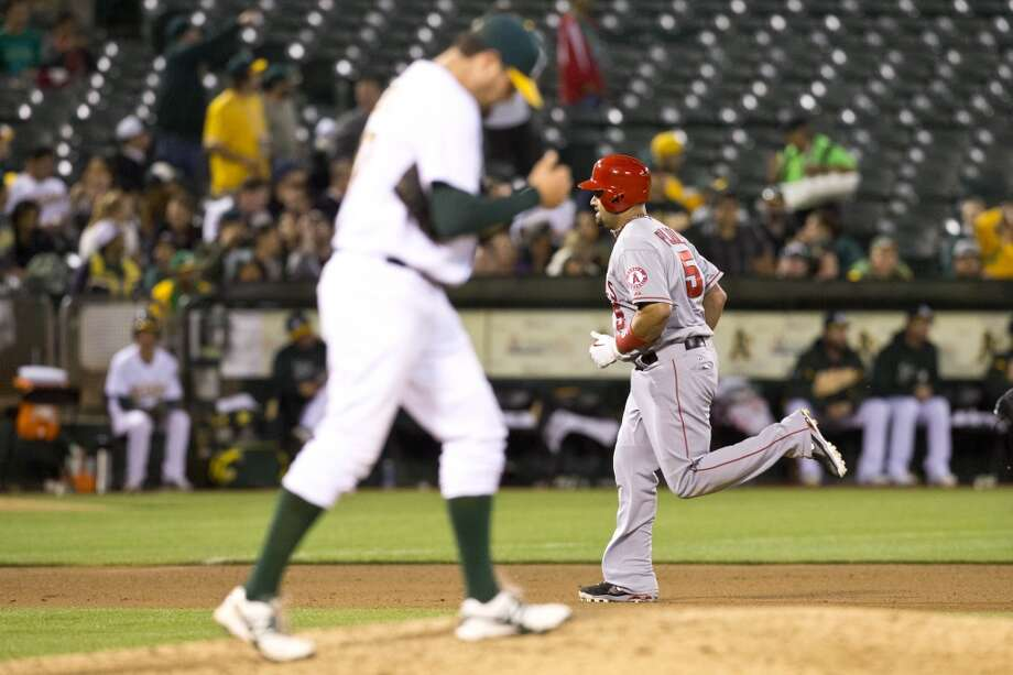 Albert Pujols (5) of the Los Angeles Angels of Anaheim rounds the bases after hitting a home run off of Pat Neshek (47) of the Oakland Athletics during the seventh inning at O.co Coliseum on April 29, 2013 in Oakland, California.