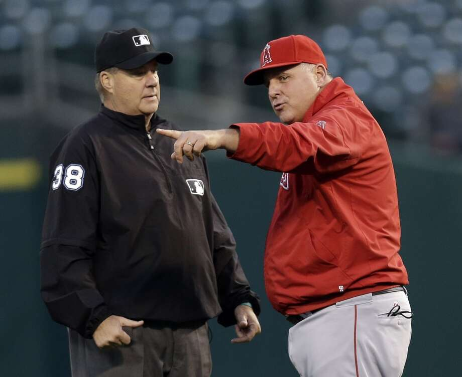 Los Angeles Angels manager Mike Scioscia argues a call by second base umpire Gary Cederstrom during the third inning of a baseball game against the Oakland Athletics on Monday, April 29, 2013 in Oakland. Calif.