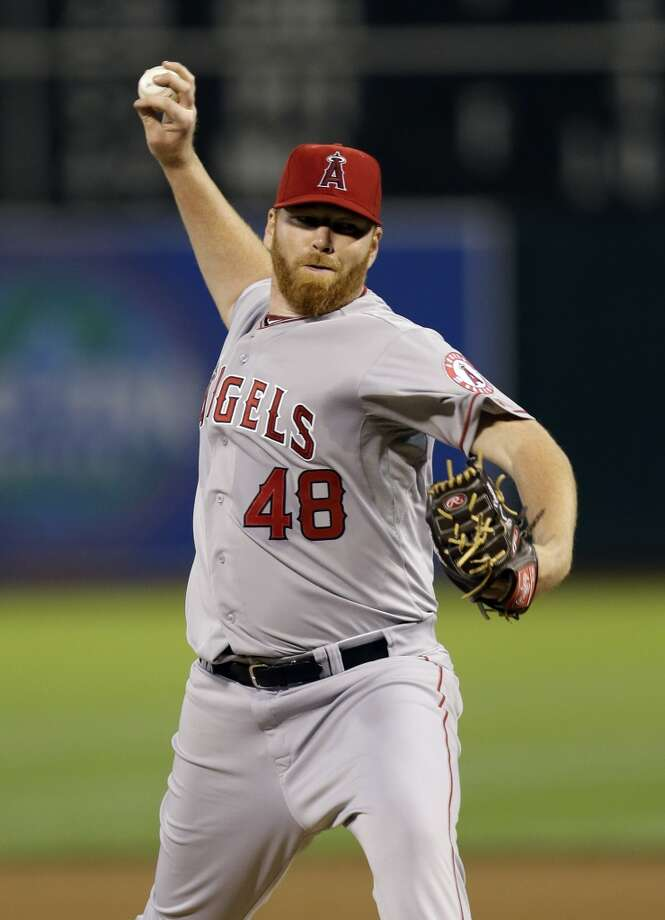 Los Angeles Angels starting pitcher Tommy Hanson throws to the Oakland Athletics during the fourth inning of a baseball game on Monday, April 29, 2013 in Oakland. Calif.