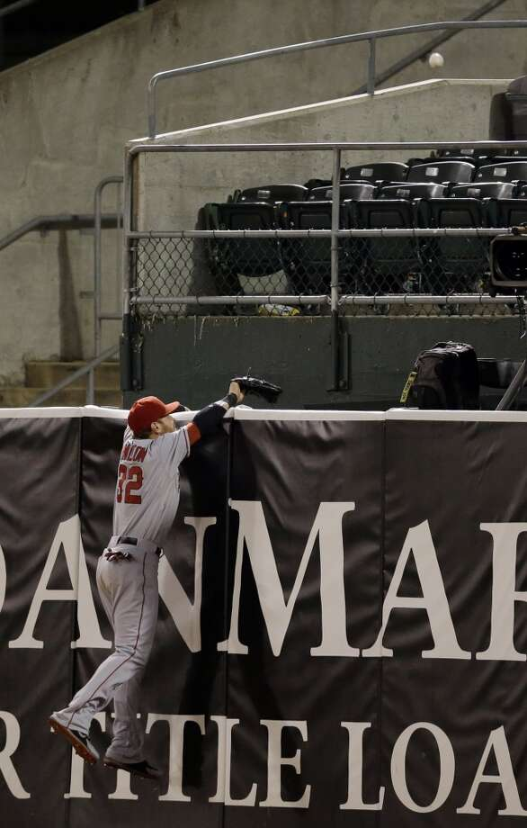 Los Angeles Angels right fielder Josh Hamilton watches a game winning two-run home run from Oakland Athletics' Brandon Moss during the nineteenth inning of a baseball game on Tuesday, April 30, 2013 in Oakland. Calif. Oakland won 10-8.