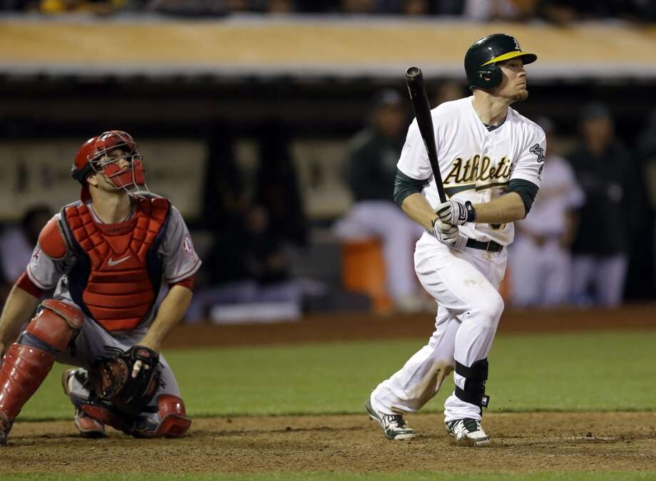 Oakland Athletics' Brandon Moss hits a game winning two-run home run against the Los Angeles Angels during the nineteenth inning of a baseball game on Tuesday, April 30, 2013 in Oakland. Calif. Oakland won 10-8.