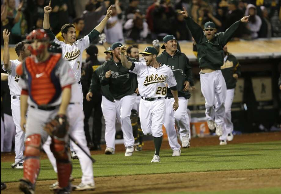 The Oakland Athletics celebrate a game- winning two-run home run by Brandon Moss during the nineteenth inning of a baseball game against the Los Angeles Angels on Tuesday, April 30, 2013 in Oakland. Calif. Oakland won 10-8 in 19 innings.