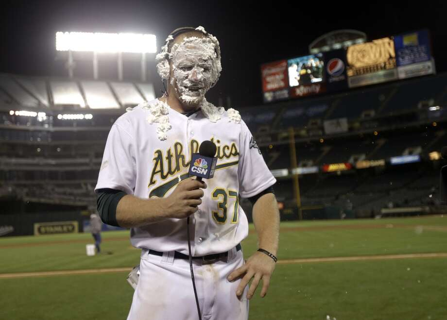 Oakland Athletics' Brandon Moss gets a shaving cream pie to the face as he conducts an interview after his game winning two-run home run against the Los Angeles Angels during a baseball game on Tuesday, April 30, 2013 in Oakland. Calif. Oakland won 10-8 in 19 innings. It was the longest game ever played in Oakland — and the longest in Angels history.