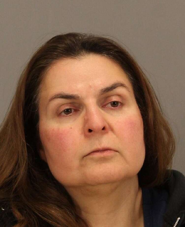 Ramineh Behbehanian, 50, was arrested Monday, April 29, 2013 for allegedly trying to sneak bottles of orange juice tainted with rubbing alcohol into a display case at a Starbucks coffee shop in San Jose, police said. Photo: San Jose Police Department, Courtesy