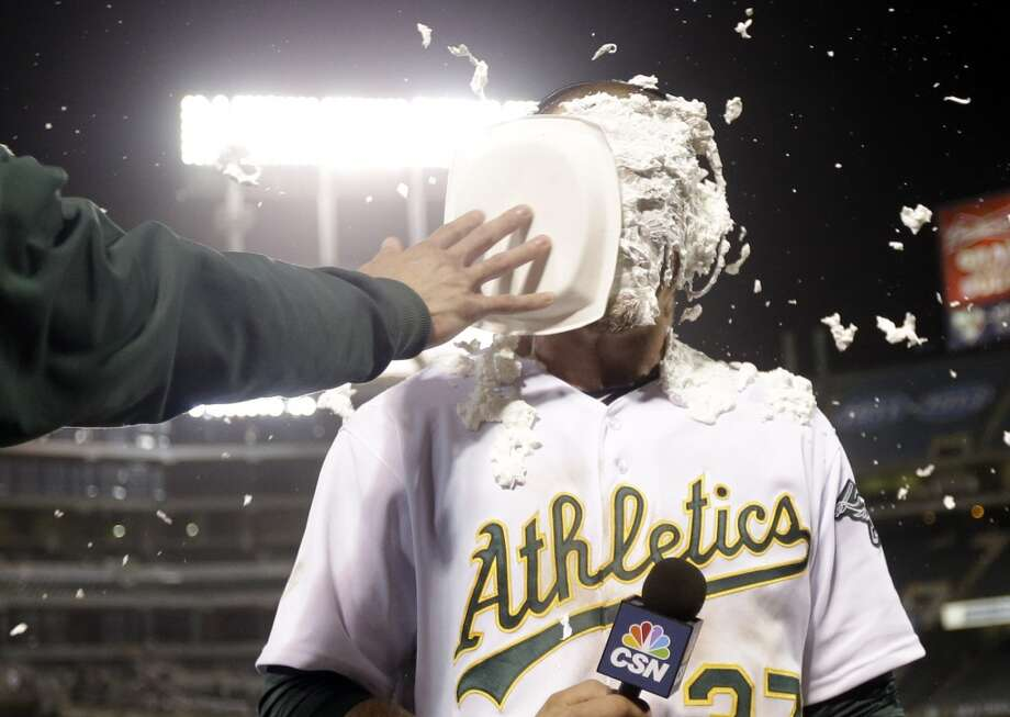 Oakland Athletics' Brandon Moss gets a shaving cream pie to the face as he conducts an interview after his game winning two-run home run against the Los Angeles Angels during a baseball game on Tuesday, April 30, 2013 in Oakland. Calif. Oakland won 10-8 in 19 innings.
