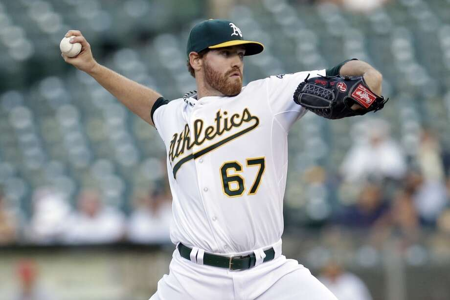 Oakland Athletics starting pitcher Dan Straily throws to the Los Angeles Angels during the first inning of a baseball game on Monday, April 29, 2013 in Oakland. Calif.