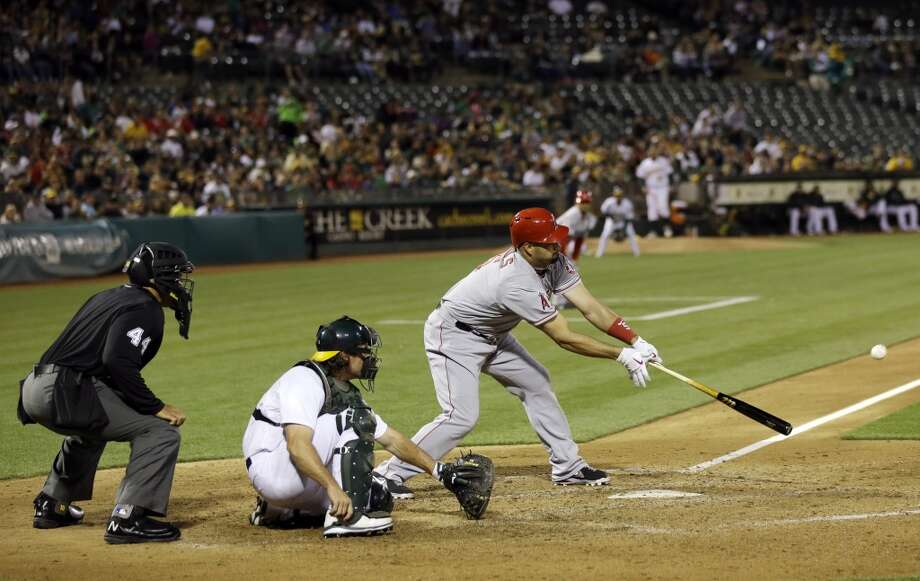 Los Angeles Angels' Albert Pujols drives in a run with a single against the Oakland Athletics during the fifth inning of a baseball game on Monday, April 29, 2013 in Oakland. Calif.