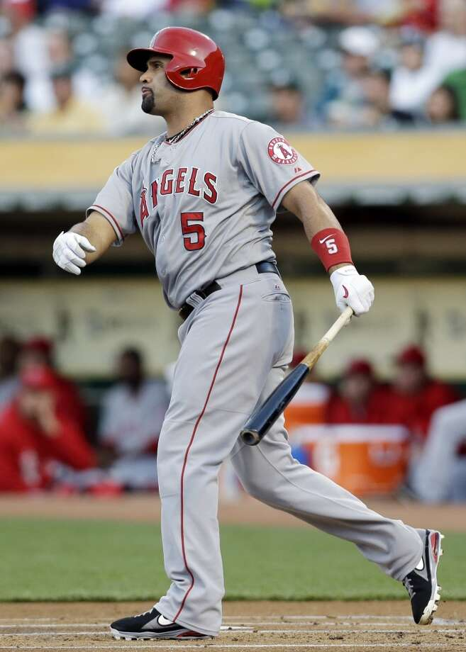 Los Angeles Angels' Albert Pujols  hits a solo home run against the Oakland Athletics during the first inning of a baseball game on Monday, April 29, 2013 in Oakland. Calif.