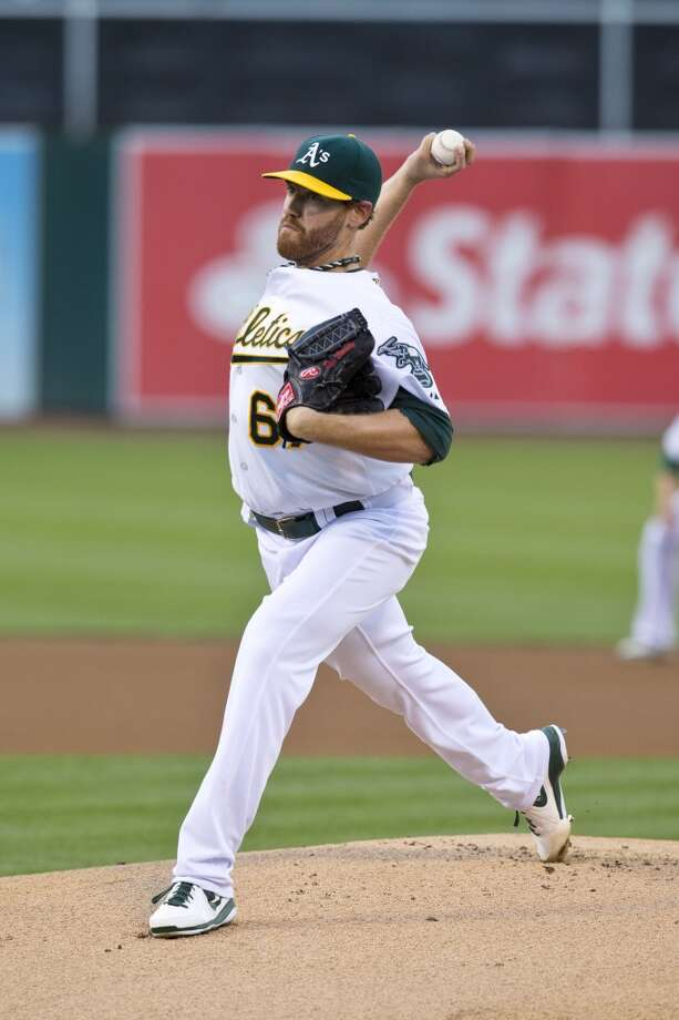 Dan Straily (67) of the Oakland Athletics pitches against the Los Angeles Angels of Anaheim during the first inning at O.co Coliseum on April 29, 2013 in Oakland, California.