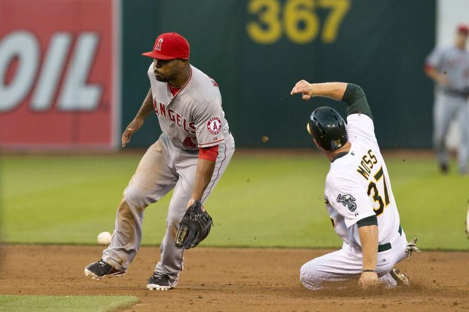 Brandon Moss (37) of the Oakland Athletics steals second base ahead of a throw to Howie Kendrick (47) of the Los Angeles Angels of Anaheim during the second inning at O.co Coliseum on April 29, 2013 in Oakland, California.