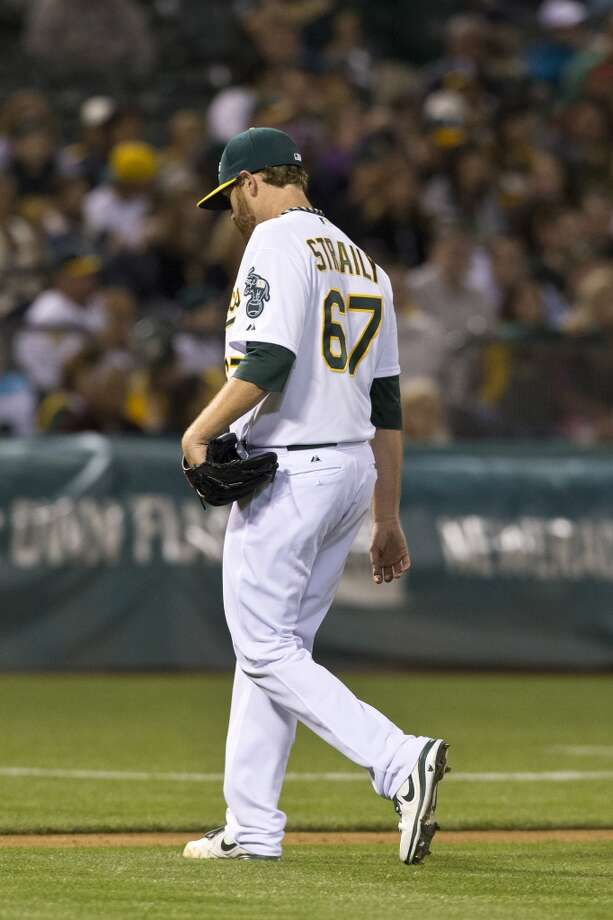 Dan Straily (67) of the Oakland Athletics returns to the dugout after being relieved against the Los Angeles Angels of Anaheim during the fifth inning at O.co Coliseum on April 29, 2013 in Oakland, California.