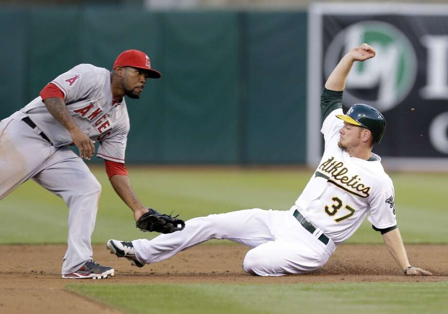Oakland Athletics' Brandon Moss (37) steals second base as  Los Angeles Angels second baseman Howie Kendrick  awaits the throw during the second inning of a baseball game on Monday, April 29, 2013 in Oakland. Calif.