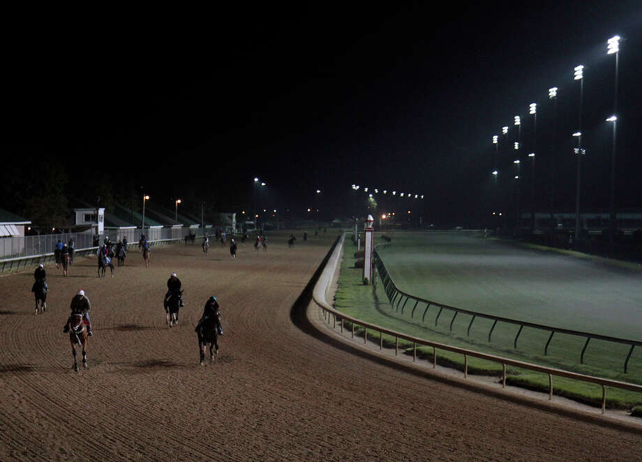 Horses make their way around the track before sunrise at Churchill Downs Tuesday, April 30, 2013, in Louisville, Ky. Photo: Garry Jones, AP / FR50389 AP