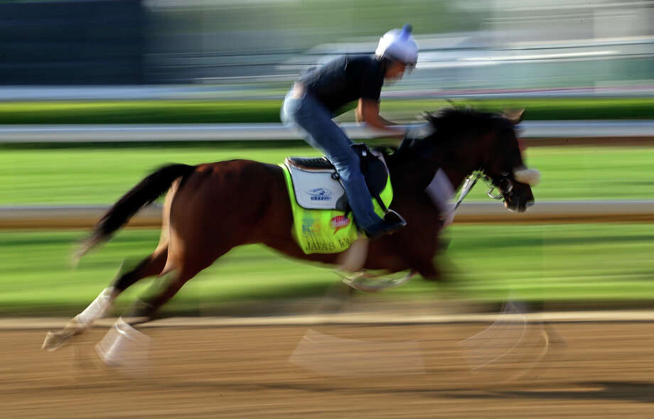 Exercise rider Marvin Abrego rides Kentucky Derby hopeful Java's War for a workout at Churchill Downs Tuesday, April 30, 2013, in Louisville, Ky. Photo: Morry Gash, AP / AP