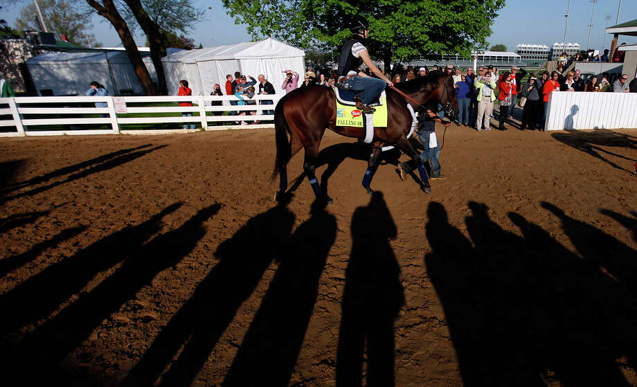 Exercise rider Cassie Garcea rides Kentucky Derby hopeful Falling Sky for a workout at Churchill Downs Tuesday, April 30, 2013, in Louisville, Ky. Photo: David Goldman, AP / AP