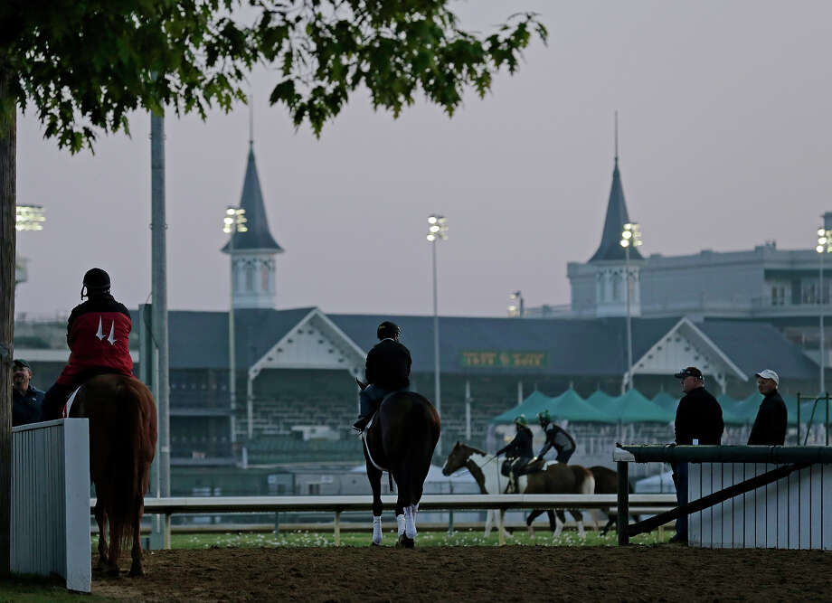 A horse makes its way to the track for a morning workout at Churchill Downs Tuesday, April 30, 2013, in Louisville, Ky. Photo: Charlie Riedel, AP / AP