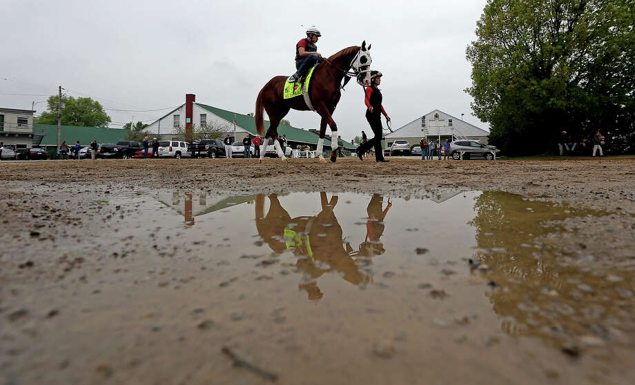 Exercise rider Rudy Quevedo rides Kentucky Derby entrant Will Take Charge for a workout at Churchill Downs Monday, April 29, 2013, in Louisville, Ky. Photo: Charlie Riedel, ASSOCIATED PRESS / AP2013