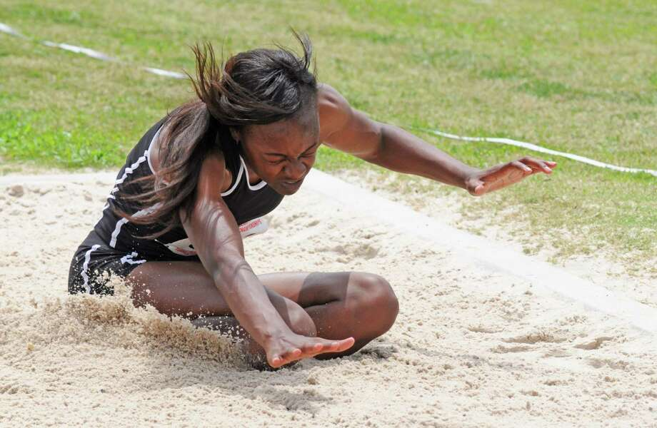 Pearland senior Tiara Johnson comes in for a landing during the Class 5A Region III triple jump on Friday in Humble. The Lady Oilers standout placed second in the event and is headed to the state meet for the first time. Photo: L. Scott Hainline / Freelance