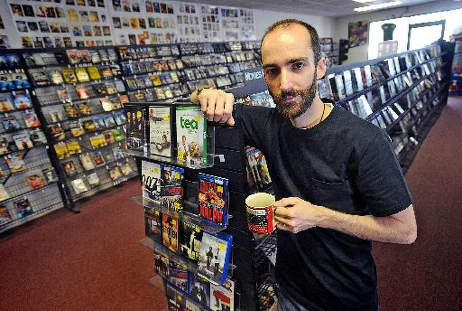 David Laurents is the manager at Movieland Video in Port Neches. Guiseppe Barranco/cat5