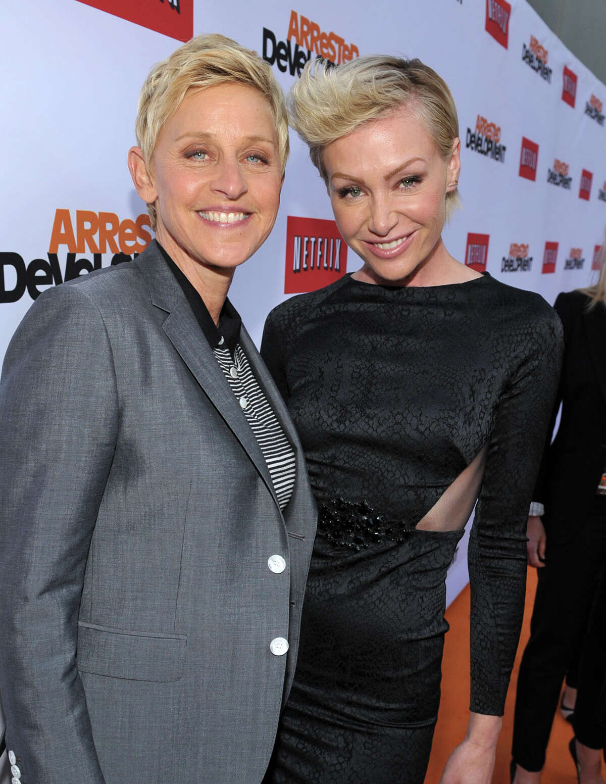 Ellen DeGeneres, left, and Portia de Rossi arrive at the season 4 premiere of