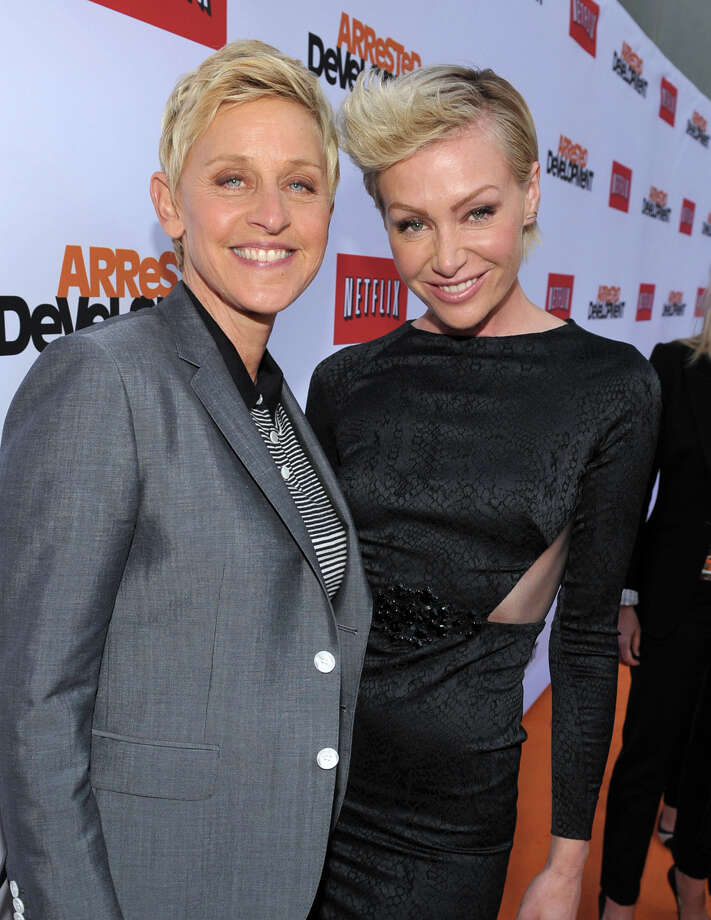 "Ellen DeGeneres, left, and Portia de Rossi arrive at the season 4 premiere of ""Arrested Development"" at the TCL Chinese Theatre on Monday, April 29, 2013 in Los Angeles. Photo: John Shearer, John Shearer/Invision/AP / Invision"